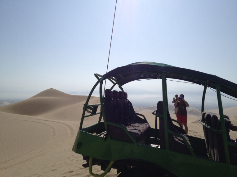 taking photos, sand dunes, Huacachina // A Slice of Peru